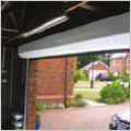 A roller garage door with a white steel canopy